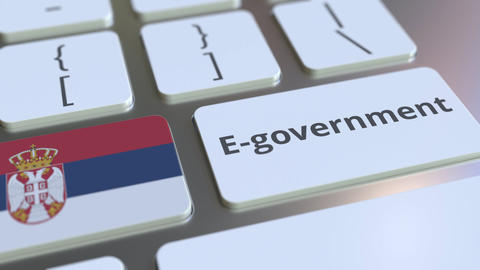 E-government or Electronic Government text and flag of Serbia on the keyboard Live Action