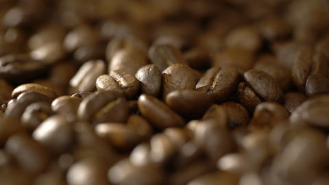 Camera re-focuses at the scattered coffee beans in the soft morning light Live Action