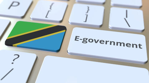E-government or Electronic Government text and flag of Tanzania on the keyboard Live Action