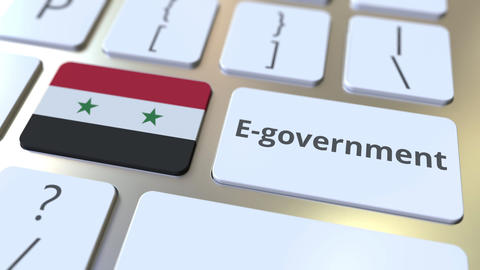 E-government or Electronic Government text and flag of Syria on the keyboard Live Action