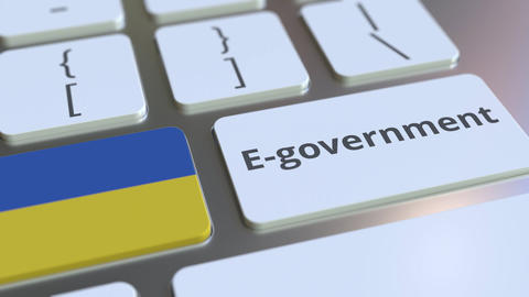 E-government or Electronic Government text and flag of Ukraine on the keyboard Live Action