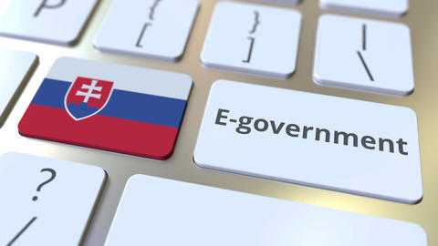 E-government or Electronic Government text and flag of Slovakia on the keyboard Live Action
