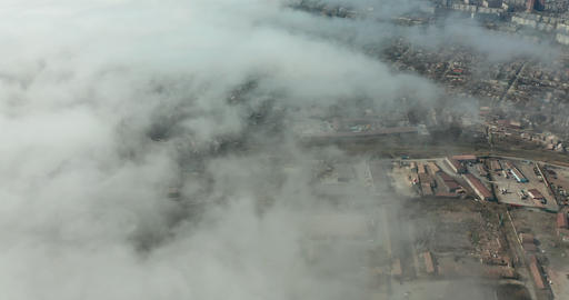 Aerial view. Scenic aerial view through moving white clouds. Fog Live Action