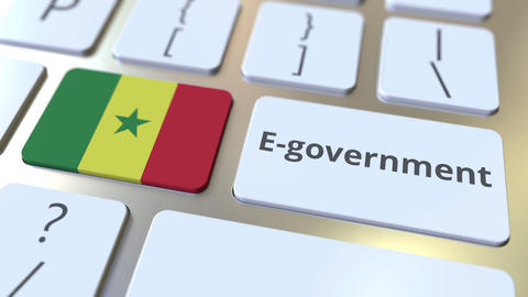 E-government or Electronic Government text and flag of Senegal on the keyboard Live Action