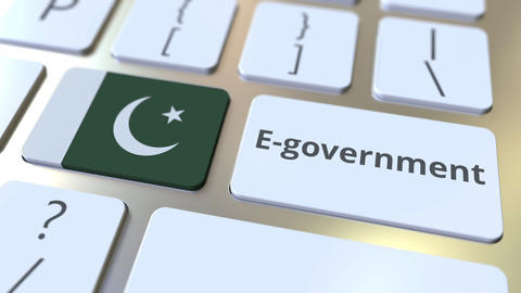 E-government or Electronic Government text and flag of Pakistan on the keyboard Live Action