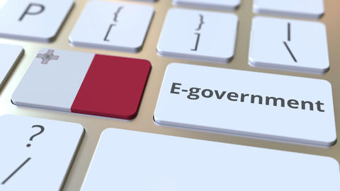 E-government or Electronic Government text and flag of Malta on the keyboard Live Action