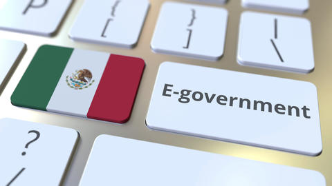 E-government or Electronic Government text and flag of Mexico on the keyboard Live Action