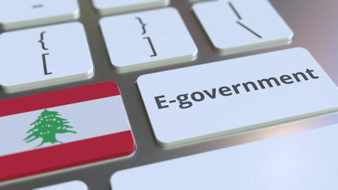 E-government or Electronic Government text and flag of Lebanon on the keyboard Live Action