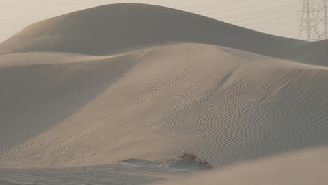 Sand dunes in the desert of Dubai during the wind Live Action