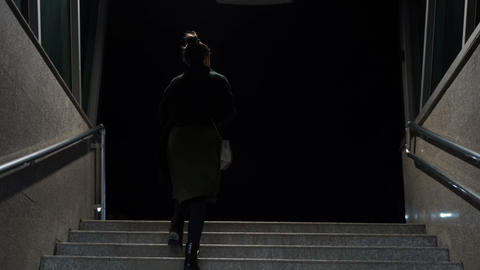 Woman walking the subway staircase alone at night. Horror, kidnap concept Live Action