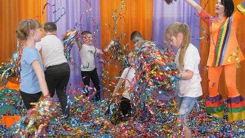 Colored ribbons fly in different directions. Bright children's emotions Live Action