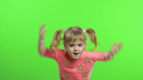 Positive girl in pink blouse dancing. Happy four years old girl. Chroma Key Live Action