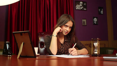 Businesswoman conducting job interview, making notes at meeting Live Action