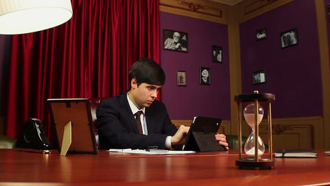 Man CEO working on tablet, startup, checking financial news Footage