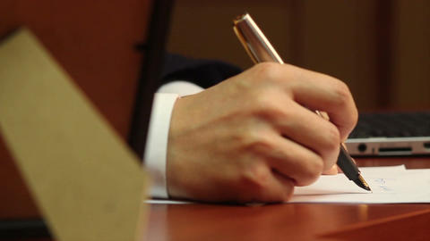 Male worker making notes, handwriting, businessman at work Footage