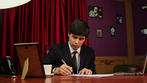 CEO, young businessman signing papers, contract, agreement Footage