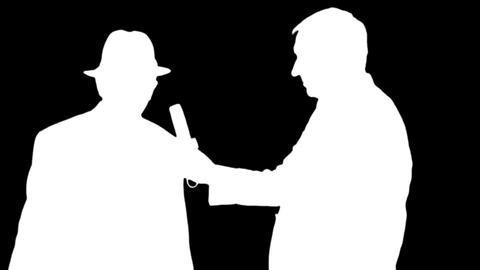 Silhouettes of the reporter interviews a man in hat on black & white background Footage