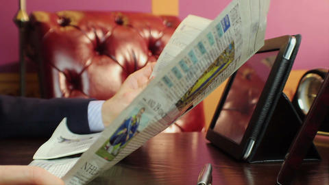 Businessman reading morning press, getting financial updates Footage