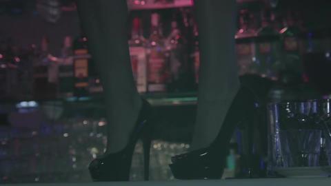 Woman legs in high heels dancing on nightclub bar counter Footage