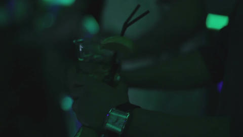 Young man hanging out at nightclub, drinking cocktail Footage