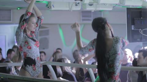 Two hot girls go-go dancing at popular nightclub Footage