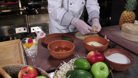 Chef decorating a dessert, pancakes with wild berries and jelly Footage