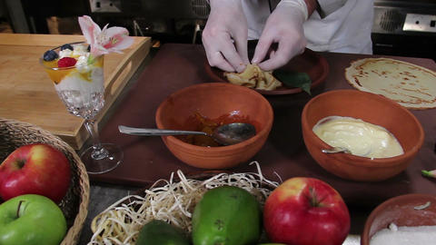 Cook making desserts with wild berries in restaurant kitchen Footage