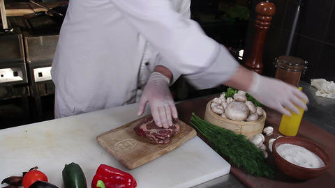 Chef preparing piece of meat for cooking on barbecue grill Footage