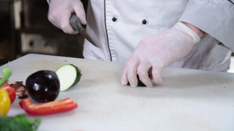 Cook's hands slicing fresh vegetables on board, cooking process Live Action