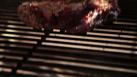 Grilling steak on flaming charcoal barbecue, cooking process Footage