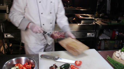 Restaurant chef taking meat off the flaming charcoal grill Footage