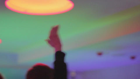 Male clubber waving hands to disco music, partying in nightclub Footage