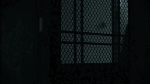 Silhouette of man figure opening door, dark scary thriller Footage
