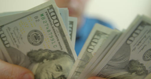 Man counting dollar bills. Close up of male hands count money cash. Money Live Action