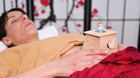 Alternative therapist applying moxibustion a traditional chinese medicine method Live Action