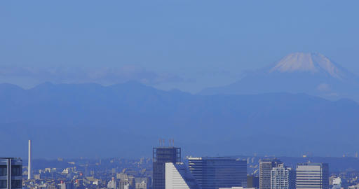 A high angle cityscape at the urban city behind Mt. Fuji in Tokyo long shot Live Action