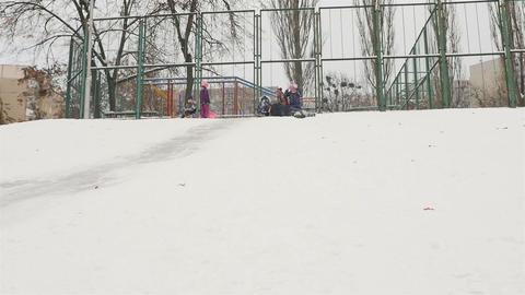 Children's entertainment on a snow slide. Slow motion 01.10.2020 Ukraine, Kiev Live Action