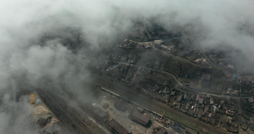 Aerial view of smog and pollution hanging over city Live Action