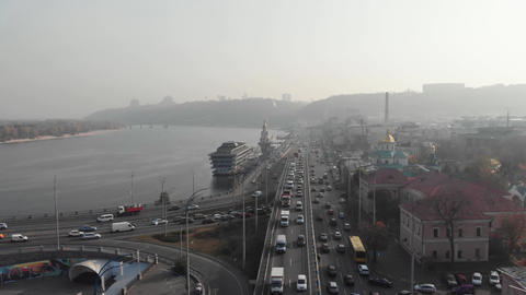 Kyiv / Ukraine - October 25 2019: Smog foggy old city promenade aerial high angle traffic pollution Live Action