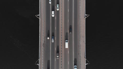Highway bridge traffic aerial top view time-lapse high speed cars Live Action