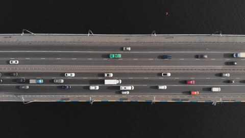 Bridge highway cars traffic aerial top view tracking shot Live Action