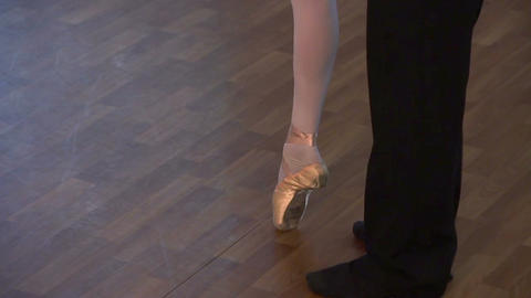 Couple's feet on the dance floor, man twirling woman around Footage