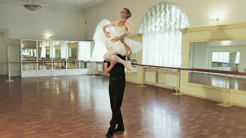 Couple ballet dancing, young man carrying ballerina on shoulder Footage