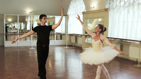 Ballet dancing in the studio, couple practicing dancing moves Footage