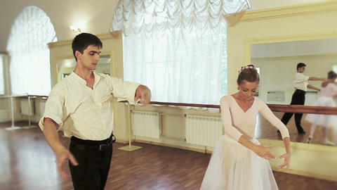 Beautiful couple performing ballet moves together, pas de deux Footage
