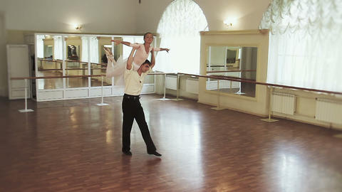 Ballet dancing, elegant couple rehearsing ballet moves in studio Footage