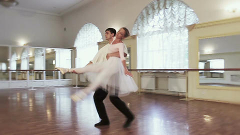 Couple practicing classical ballet dance in gym, slow-motion Footage
