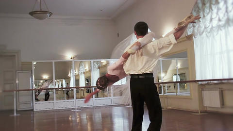 Classical ballet dancing, man flips woman upside down and twirls Footage