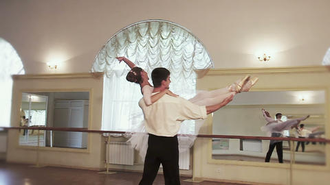 Positive elegant couple practices ballet moves in studio, slowmo Footage