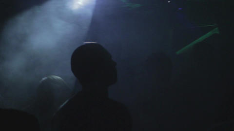 Clubbers waving hands to the music on dance floor, nightclub Footage